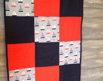 Handmade Baby Quilt - Modern nautical quilt for the baby sailor!  100% cotton sailboats in red and navy, nautical baby quilt.