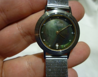 A18 Grennan of Denmark Wrist Watch with Date Function and Rainbow Hued Dial.