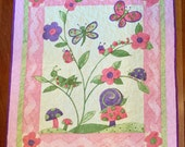 """Handmade baby toddler quilt featuring animals and butterflies 38"""" x 43""""  pastel colors, Susan Winget design"""