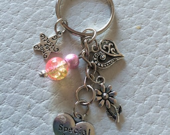 Special Friend Keyring Gift with pink Beads and a pillow gift box.