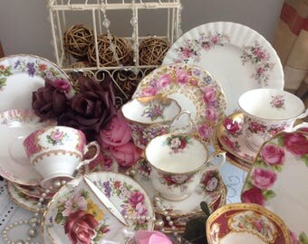 Vintage mis-matched tea set for six. Pretty pinks. Bone china