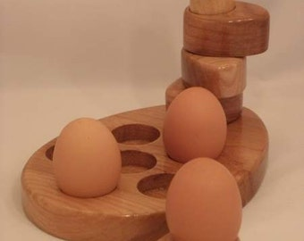 Egg rack with matching egg cups.