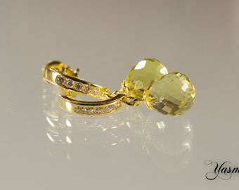 Faceted citrine with cubic zirconia