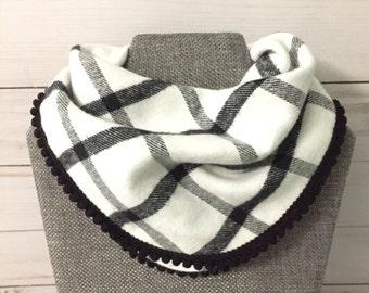 Baby girl pom pom bib, black and white plaid
