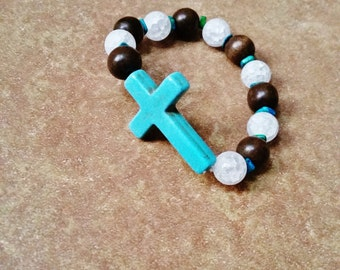 Handmade Turquoise Cross Bracelet. Cracked Crystal Quartz and Wooden Beads Accented with Blue Green Greek Mykonos Beads. One of a kind!