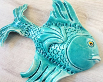 Two ceramic fish turquoise and yellow wall decor