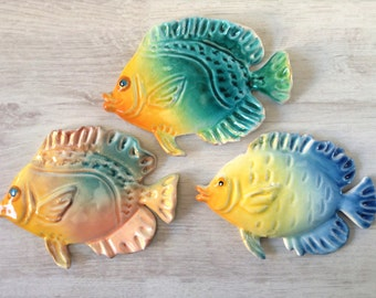 Three small colorful fish ceramic wall decor