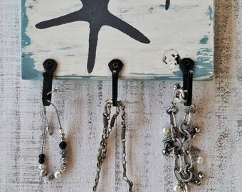 Whimsical beach cottage, shabby chic starfish key/jewelry three wall hook plaque