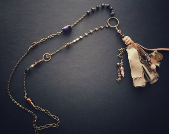 Mixed chains, silk and tassel pendants
