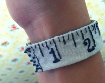 Hand embroidered textile wrist cuff, vintage bracelet, tape measure, navy blue- jewellery