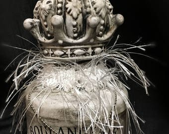 Antique white bottle with a crown