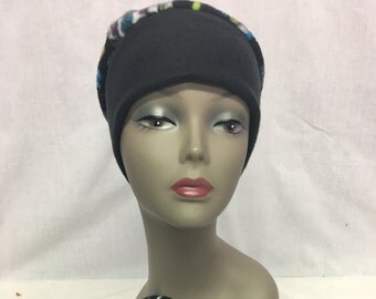 Fleece cap with black,purple,green band hat has skylls on it made of fleece unline