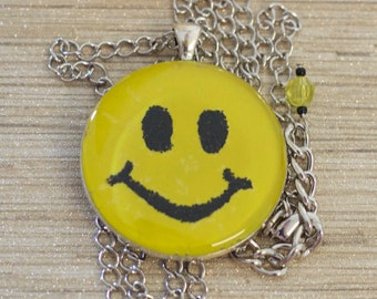 Smiley face pendant necklace handmade with yellow melted crayon and black glitter sealed in clear resin // gift for her // happy face //