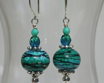 lampwork bead earrings in teal, green, and black