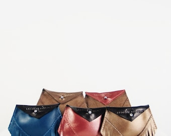 Leather wallet by L.