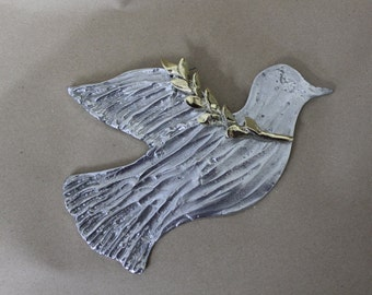 Bird with twig , made of solid bronze and aluminium.