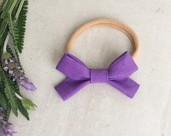 purple mini bow, baby bows, newborn bows, baby bow headband, bow clips, classic bow, black baby bow, nylon headband, baby headbands