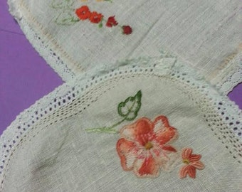 Vintage hand embroidered doilies with crocheted edges