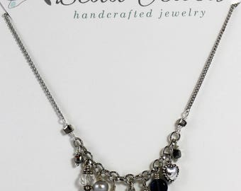 Silver necklace with multi-charm.