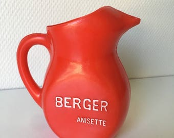 French water jug. Vintage Berger Anisette pastis carafe in red plastic
