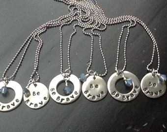 Pewter washer hand stamped with Be Brave hung on a sterling silver chain
