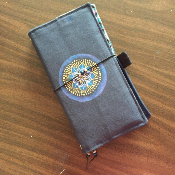 Handcrafted canvas journal for use in planning, traveling, journaling, artwork, and more