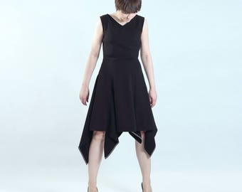 black flared rebel dress with godets fitted at the waist, irregular hem finished with black and white trimming, grunge rock avantgarde style