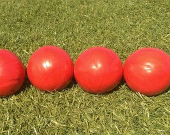 Four well made professional juggling balls 120g each, red