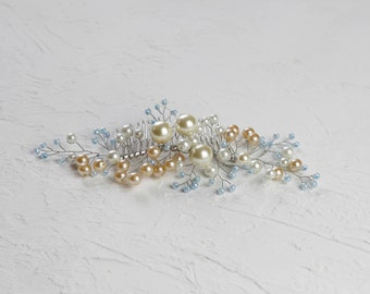 pearl beads in different sizes, metallic hair comb, jewelry wire