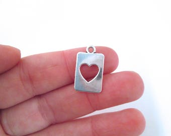10 silver plated open heart charms, G82