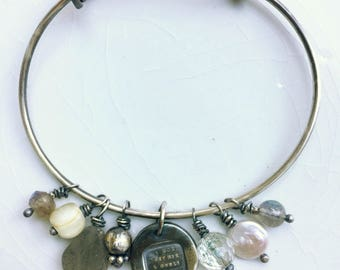 Cara, charm bracelet with antique wax seal charm and semi-precious stones.