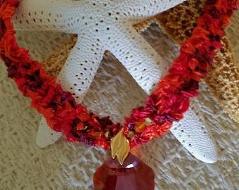 Handknit ribbon yarn necklace with 28mm Swarovski crystal sea shell focal bead, Swarovski crystal accents