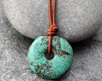 Etsy your place to buy and sell all things handmade mens turquoise pendant on adjustable leather cord turquoise donut pi bead december birthstone aloadofball Image collections