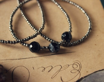 Mojo | Dark Half. Rustic Bohemian Hand Strung Seed Bead and Snowflake Obsidian Necklace.