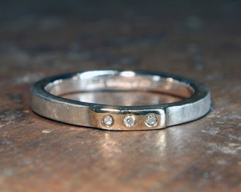 """2mm stone set """"Woodland"""" ring. Recycled sterling silver & 9ct or 18ct gold, ethical lab grown moissanite. Hand made in the UK."""
