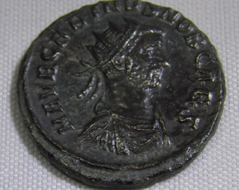 Authentic Roman Coin of Carinus,  Reverse; Emperor at standard 282-285 A.D.