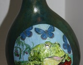 gourd birdhouse with frog and butterflies