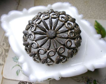 Vintage Rustic Monet Metal Brooch   Signed Round Silver Tone Metal Floral Pin   Daisy Center, Scrolls, Scalloped Edge   Oxidized Antiqued