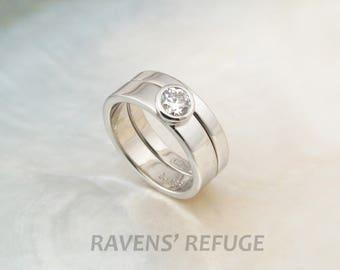 palladium bridal set with tapered bezel-set diamond engagement ring