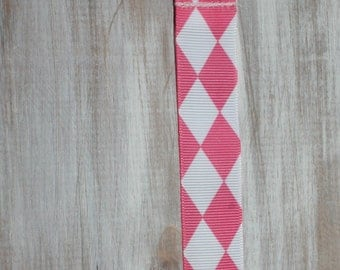 Baby girl pink and white diamond checked ribbon suspender binky clip