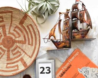 vintage copper metal ship bookends / sculpture