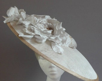 off white grey (ish) with gold saucer hat with ton sur ton flowers on comb perfect for derby day