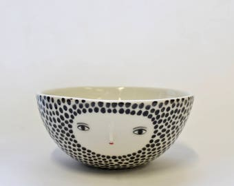 Porcelain spotty bowl with sculpted face