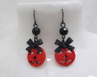 Creepy Cute Grinning Halloween Jack-o-lantern Beaded Dangle Earrings with Black Bows