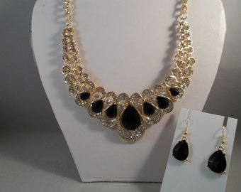 Gold Tone Bib Necklace with Teardrop Black Crystals and Clear Rhinestones with Matching Earrings