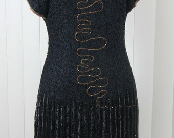 Flapper style, that will fit like a wiggle dress.  Little Black Dress like you have never seen it before -ROCK your New Year