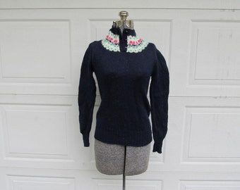 1960s vintage girls' Shetland wool sweater with high neck and flower trim