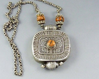 """Old Silver tibetan """"ga'u"""" amulet box pendant, with a central coral bead, tibetan jewelry, buddhist amulet, ethnic and tribal necklace"""