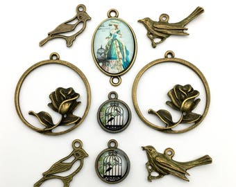 9 bird charms and glass pendants,  bronze tone 18mm / 35mm #ENSB 123