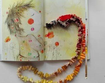 Wooden long necklace with colored pencils in shades of yellow, Orange and Brown